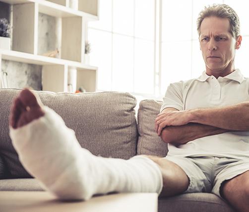 man with broken leg in a cast