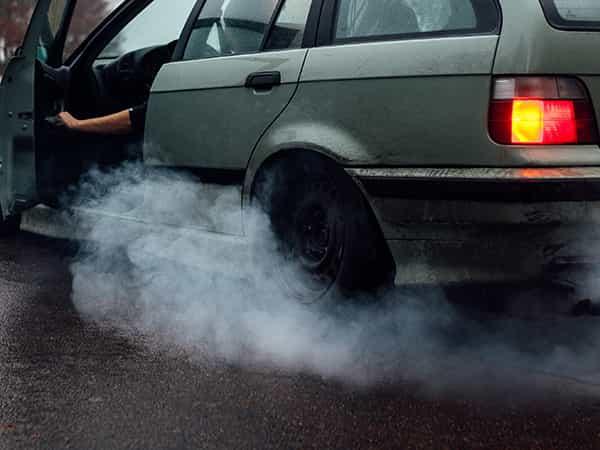car in smoke